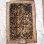 Carved panel used in custom cupboard