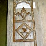 Antique cast grillwork for gate peep shutter