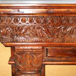 Detail of antique fireplace surround carving