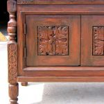 Detail of buffet with carved panels and legs