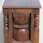 Side of buffet with carved panels and legs