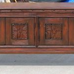 Front of custom buffet cabinet with carved panels and legs