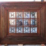 Grilled transom with intricate carving