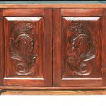 Vanity base cabinet with hand carved panels