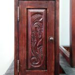 Custom medicine cabinet with carved panel