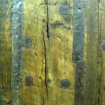 Salvaged tin patching detail on custom bathroom door