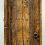 Front of custom rustic bath door
