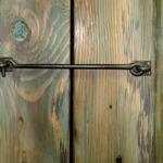 Hook and eye closure for barn sliding doors