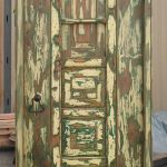 Front of antique Mexican door with shutter