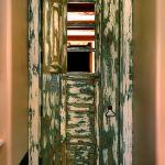 Antique Mexican door with operable shutter