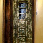 Antique Mexican door with shutter