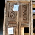 Antique door with carved panels used to make fireplace mantel