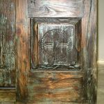 Antique carved panel set into base of front entry side light