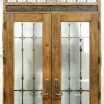 Doors with grilled arched transom