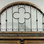 Custom grilled arched transom