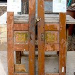 Antique cabinet doors used to make wooden shutters with carved panels