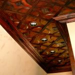 Wooden ceiling tiles with recessed lighting
