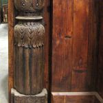 A section of the kitchen island accented with antique columns