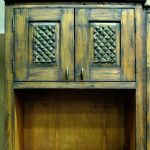 Custom rustic kitchen cabinet with carved panels