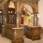 Custom home bar with arches and columns