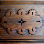 Carved panel detail for bath linen cabinet