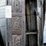 Antique cabinet with carved panels used to make freestanding bathroom linen cabinet