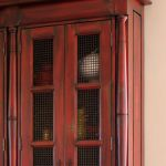 Custom red hutch crown moulding detail