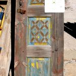 Antique cupboard door with carved panels