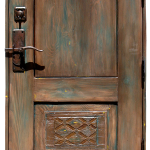 Solid wood entry gate crafted using antique carved panels, reclaimed Douglas fir and stamped tin to trim the top. It features hand cast bronze handle hardware with deadbolt.