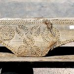 Antique corbel used to make mantel with surround