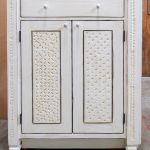 Bath cabinet with carved panels