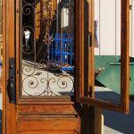 Custom front door with operable shutter