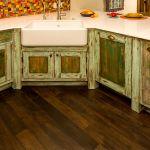 Custom sink area green kitchen cabinets