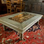 Coffee table with antique grillwork installation photo