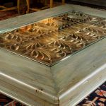 Antique grillwork detail on coffee table installation photo