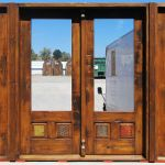 French doors with carved panels