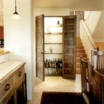 Custom bar pantry doors made with antique Mexican doors