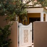 Installed custom gate with carved panel