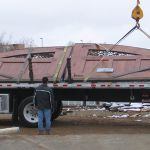Loading of dealership gates onto truck for shipping