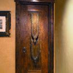 Door with operable shutter and antique carved door
