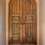 Arched interior doors made with antique Mexican doors