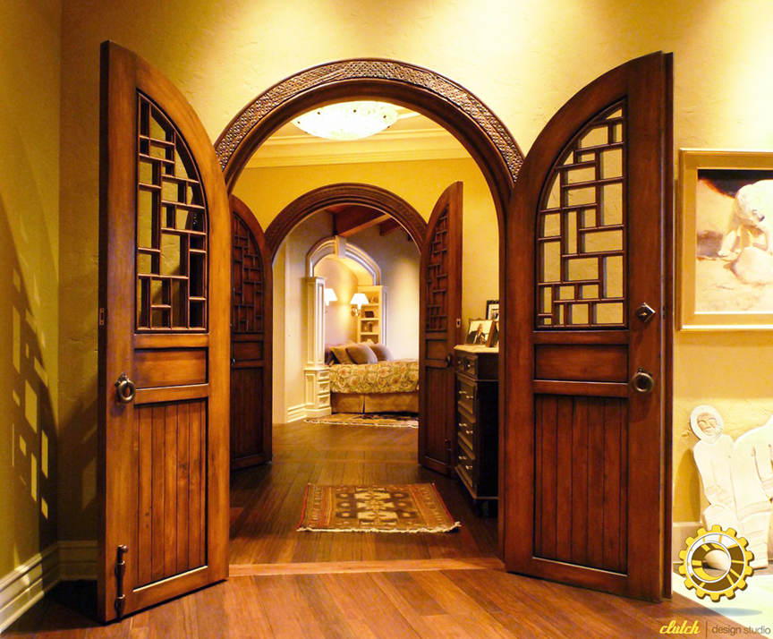 Installation photos of custom arched doors kitchen cabinets and a bench installation photos of custom arched doors with carved surrounds custom kitchen island and cabinets and a custom gallery bench inset with antique material planetlyrics Gallery