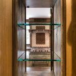 Detail of pass-thru kitchen cabinet
