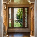 Antique carved column accents doorway