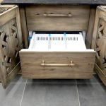 Cabinet doors reveal refrigerated drawer in custom bar cabinet