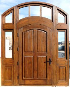 Arched door with sidelights