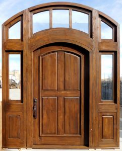 Arched door with transom and sidelights