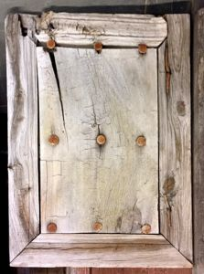 Antique mesquite panel with iron clavos