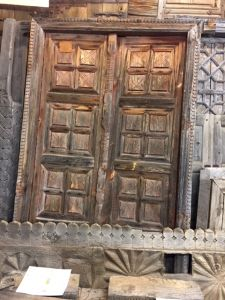 Antique carved door with surround
