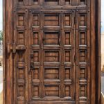 Door-within-a-door made from salvaged lumber